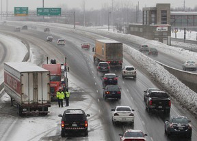 Freezing rain and 15 cm of snow is expected in Ottawa Tuesday, Jan. 17,  2012.  A truck accident on the 417 near Bayshore caused traffic problems Tuesday. (Tony Caldwell/Ottawa Sun)