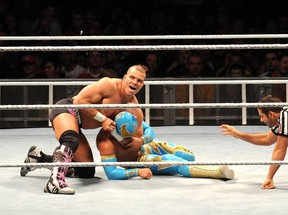 Tyson Kidd (top), shown wrestling Sin Cara in Dublin last year, believes he has what it takes to be a WWE superstar. (Photo courtesy WENN.com)