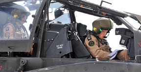 A handout image obtained on February 8, 2012, in London, from Britain's Ministry of Defence shows EX Crimson Eagle Capt Wales (also known as Britain's Prince Harry) preparing to go out on an Apache helicopter training mission at the Naval Air Facility (NAF) El Centro in California. Prince Harry has become a fully operational Apache Attack Helicopter Pilot after successfully completing 18 months of intensive training. AFP PHOTO/SGT RUSS NOLAN RLC/BRITISH MOD/HANDOUT