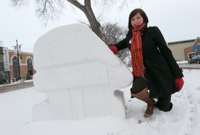 Festival du Voyageur director of marketing and communications Emili Bellefleur stands with one of the festival's snow sculptures along Provencher Boulevard on Feb. 1, 2012. (Jason Halstead/QMI Agency)
