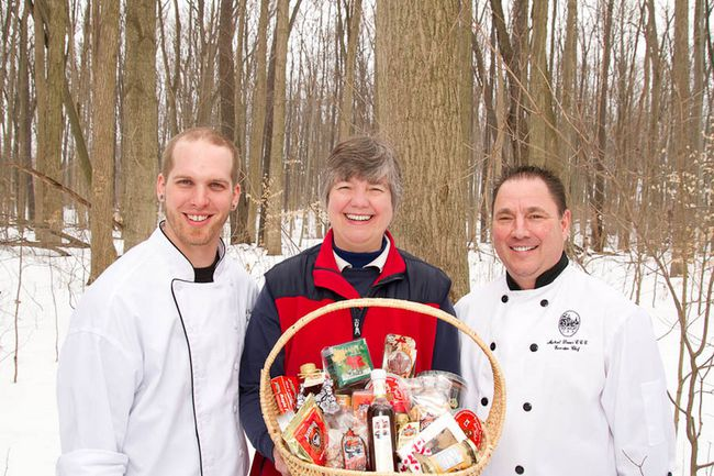 Eric Boyar (left), owner/chef at Six Thirty Nine, and Michael Davies, executive chef at the Elm Hurst Inn and Spa, with Mary Jakeman picking up maple syrup for their special March menus. (Handout – Oxford Tourism)