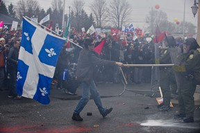 Students confront riot police during a protest against hikes in tuition on May 4, 2012 as the annual Liberal Convention is being held in Victoriaville, Quebec, Canada. (AFP PHOTO/ROGERIO BARBOSA)
