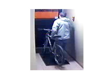 Police issued this surveillance photo after someone broke into a parkade at an apartment building near 100 Avenue and 118 Street on May 12.