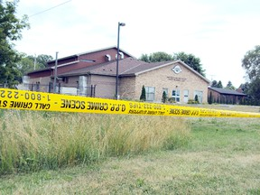 Police tape cordons off the crime scene near the Walpole Island water treatment plant, where the body of Clifford Lincoln Riley, 50, was discovered. (QMI Agency)