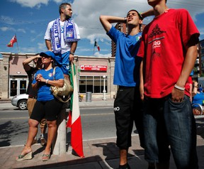 Italian football supporters Desiree Battisti and husband, Tony, above, watch the Euro 2012 final against Spain at Paesani's Caffe on Preston St. in Ottawa's Little Italy Sunday, July 1, 2012.  (DARREN BROWN/Ottawa Sun)
