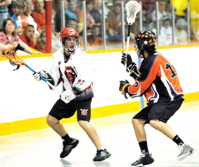 Wallaceburg Red Devils' Ryan Charteris, left, is defended by Six Nations Rebels' Jacob Crans on Sunday at Wallaceburg Memorial Arena. (MARK MALONE/QMI Agency)