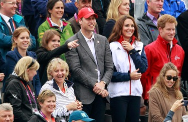 From left to right: Princess Beatrice, Princess Eugenie, Prince William and his wife Catherine, Duchess of Cambridge, and Prince Harry watch the eventing individual jumping final equestrian event at the London 2012 Olympic Games in Greenwich Park July 31, 2012. (REUTERS/Luke Macgregor)
