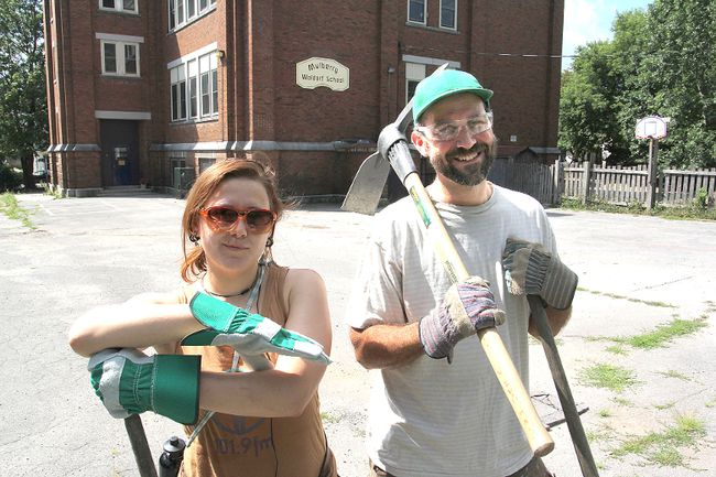 Hearthmakers project co-ordinator Jolene Simko, left, and parent volunteer Erik Coleman from Mulberry Waldorf School are ready for next weekend's depaving project in the schoolyard.
