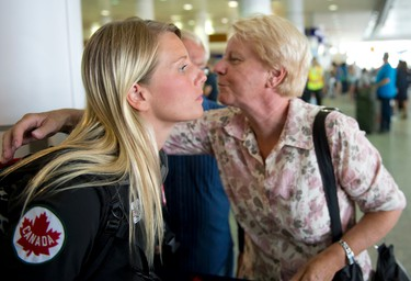 Canadian diver Emilie Heymans hugs her mother Marie-Paul prior to leaving for the London 2012 games at the Pierre Trudeau Airport in Montreal on Monday July 16 2012. PIERRE-PAUL POULIN/ QMI Agency