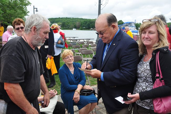 Former NHL coach Scotty Bowman greets fans and signs autographs Saturday in Hastings during celebrations in honour of Hastings hockey hero Dit Clapper.