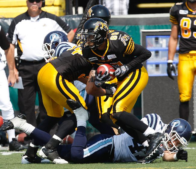 Tiger-Cats kick returner Chris Williams breaks and Argonaut tackle at Ivor Wynne Stadium in Hamilton, Ont., Sept. 3, 2012. (CRAIG ROBERTSON/QMI Agency)