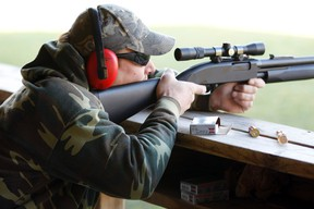 A hunter fires during a sighting in and test-firing of shotguns and rifles in a safe environment for the upcoming deer hunting season at the Illinois State Police firing range in Joliet, Illinois on November 12, 2011. (REUTERS/Jeff Haynes)