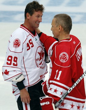 Wayne Gretzky greets Russia's Igor Larionov after their exhibition ice hockey game in St. Petersburg, September 5, 2012. (Alexander Demianchuk/REUTERS)