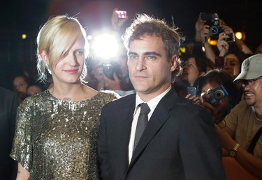 """Joaquin Phoenix arrives with guest Heather Christie on the red carpet for the gala presentation of the film """"The Master"""" at the 37th Toronto International Film Festival, September 7, 2012. (REUTERS/Mark Blinch)"""