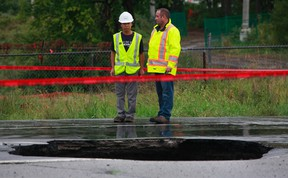 Hwy. 174 east bound was closed for days in September after a giant sinkhole swallowed a car. (File photo/Tony Caldwell/Ottawa Sun)