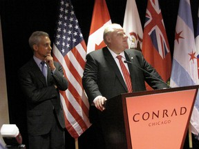 Toronto Mayor Rob Ford and Chicago Mayor Rahm Emanuel at a press conference in Chicago signing the joint sister cities declaration in this file photo from Sept. 19, 2012. (DON PEAT/Toronto Sun files)