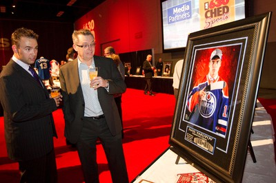 Gala attendees look over the items up for silent  auction during the Legends Experience, an annual Kinsmen gala fundraiser, at the Edmonton Expo Centre in Edmonton, Alberta on Friday, September 21, 2012.  Mark Messier was on hand as the feature for the event. AMBER BRACKEN/EDMONTON SUN/QMI AGENCY