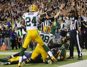 A referee indicates a Seattle Seahawks game winning touchdown over the Green Bay Packers during the fourth quarter of their NFL football game in Seattle, Washington, in this September 24, 2012 file photo. (REUTERS)
