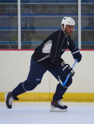 Dustin Byfuglien of the Winnipeg Jets takes part in a practice arranged for players during the lock-out in St. Louis Park, Minnesota on Thursday Sept. 27, 2012.  Marilyn Indahl/QMI Agency