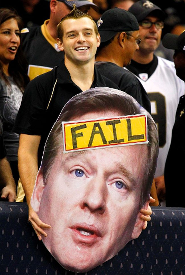 A spectator holds up a cutout of NFL Commissioner Roger Goodell during a game in New Orleans on Sept. 9, 2012. Goodell wrote a letter to fans on Friday addressing the referee fiasco. (Jonathan Bachman/Reuters/Files)