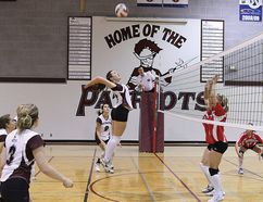 JPII Patriots middle Amanda Bourget keeps her eye on the prize as she leaps up during volleyball action on Oct. 3. The girls ended up losing to the Christ the King Chargers three games to two. The boys fared worse, going down 3-0 to Archbishop MacDonald.