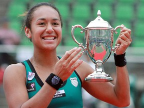 Heather Watson of Britain holds the trophy after winning the Japan Women's Open tennis tournament in Osaka on October 14, 2012. Watson defeated Chang Kai-chen of Taiwan in the final 7-5, 5-7, 7-6 (7/4) and became the first Briton in 24 years to win a WTA title.    JAPAN OUT      AFP PHOTO / JIJI PRESS