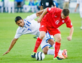 Canadian Will Johnson and Honduras' Emilio Izaguirre battle for the ball during their game at BMO Field earlier this year. (ERNEST DOROSZUK/Toronto Sun)