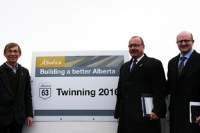 Fort McMurray MLAs Mike Allen, left, and Don Scott, right, join transportation minister Ric McIver for the unveiling of a newly-twinned 36-kilometre stretch of Highway 63 outside Wandering River. McIver announced that the province will twin the highway by the fall of 2016. VINCENT MCDERMOTT/TODAY STAFF