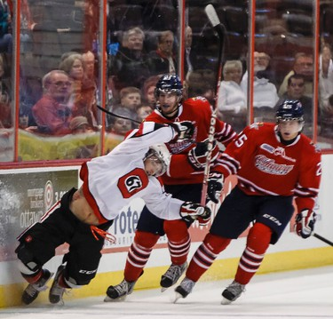 Ottawa 67's Taylor Fielding gets hauled down by Oshawa Generals #23 Scott sabourin and #25 Colin Suellentrop during OHL action at Scotiabank Place in Ottawa on Wednesday October 24,2012. (Errol McGihon/Ottawa Sun/QMI Agency)