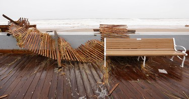 A beach fence is washed up onto the boardwalk in Ocean City, Maryland as Hurricane Sandy intensifies on October 29, 2012. (REUTERS/Kevin Lamarque)
