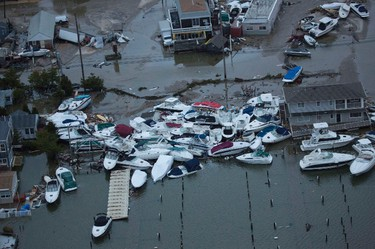 Boats are piled up between houses in an aerial view of Hurricane Sandy damage along the New Jersey coast, in this photograph taken on October 30, 2012 and released on October 31. REUTERS/Tim Aubry/Greenpeace/Handout  E TO CLIENTS