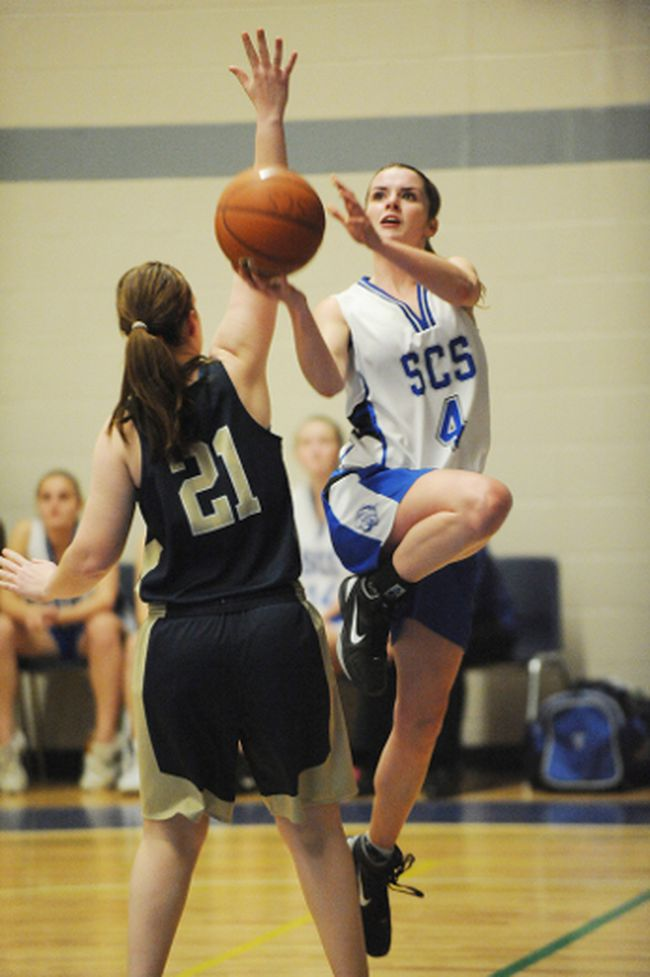 Simcoe's Gillian Ponds takes a shot as Delhi's Devin Cowbrough aims to block during the senior girls basketball NSSAA finals held at Simcoe Composite School on Nov. 8. (SARAH DOKTOR Simcoe Reformer)
