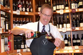 Paul Eaton, LCBO product consultant, pours a glass of Tollo Novello Rosso Terre di Chieti at the Brookdale store location. The Beaujolais Nouveau wines are some of the most eagerly awaited wines of the year. Erika Glasberg staff photo