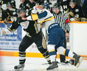 Golden Hawks defenceman Loren Ulett and Whitby's Tyler Park threw punches during the third period of last Friday's 3-2 home loss.  For more coverage see Page 30.  Justin Tang for the Trentonian