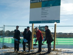 (From left) Airdrie MLA Rob Anderson, Rocky View Schools board of trustees chair Bruce Pettigrew, Airdrie Mayor Peter Brown, and Alberta Justice Minister Jonathan Denis (appearing on behalf of Education Minister Jeff Johnson), turn the sod at the site of the new Airdrie high school, to be opened in September 2014. The sod turning was the third of the day - the group also broke ground on the new Airdrie middle school site and the site of the new K-9 school in Chestermere. MARIE POLLOCK/AIRDRIE ECHO/QMI AGENCY