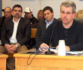 Rick Dubeau, right, spoke at the most recent city council meeting on behalf of the Hollinger Project Community Advisory Committee (HPCAC), raising concerns about the future Hollinger pit site becoming a burden for the taxpayers of Timmins. Goldcorp general manager Marc Lauzier, left, and mine supervisor Paul Miller can be seen listening in the background. Goldcorp and the city will be working with the public over the next few years to develop a Subsequent Land Use Plan to beautify the property and make it an area that residents will be proud of.