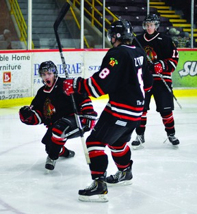 Brockville Braves forward David Ferreira celebrates one of his two goals in Friday night's win over Pembroke with teammates Zach Todd(8) and Cory Wilson. STEVE PETTIBONE/The Recorder and Times