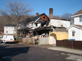 One person is dead and at least two families are dealing with  water and smoke damage to their homes after 91 St. Therese Street caught fire in Temiscaming, Que. Friday night.