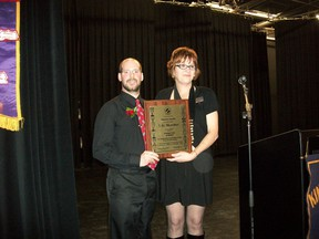 Moe Lacroix (left) is presented with a life membership in Kin Canada by District 3 (Saskatchewan) governor Sandi Barrie at a celebration held Saturday, November 17 in Melfort.