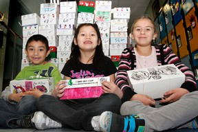 A group of Grade 2 students pose with their shoeboxes for Operation Christmas Child at Parkdale School in Wetaskiwin Nov. 13. Operation Christmas Child is a project of Samaritan's Purse, and since 1993 has been sending shoeboxes full of gifts to children in more than 130 countries.