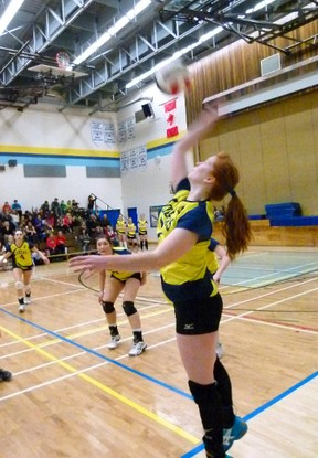 FHS Cobras' Marcy Osowetski returns a serve during the Cobras first game of the Zones tournament, playing the St. Andrews Saints. (Chris Eakin/Fairview Post)