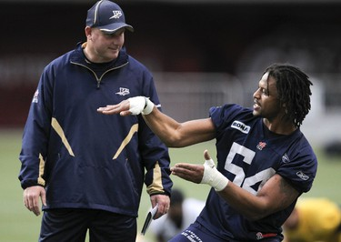 Winnipeg Blue Bombers Kenny Mainor jokes with head coach Paul LaPolice during a team practice at BC Place in Vancouver, B.C. Nov 25, 2011. (ANDRE FORGET /QMI AGENCY)