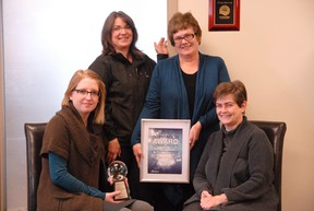 PACE employees–therapist Amanda Unsworth (left), in-house support co-ordinator Rhonda Rousell, executive director Jacquie Aitken-Kish and therapist Susan Marshall– proudly display the Alberta Inspiration Award the organization won for its work in family violence in the Peace Country. (Patrick Callan/Daily Herald-Tribune)