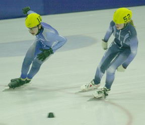 Northern Lites Speed Skating teammates Carson Kinshella (left) and Arianna Loogman (right) participate in the 1,500 metre event during the clubís ability meet at the Baytex Energy Centre on Saturday, Nov.17.