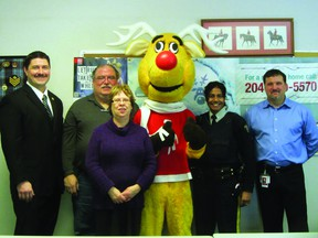 City councillor Ryan Espey, Operation Red Nose coordinator Leo Lapointe, Judy Murphy, President and CEO of Safety Services Manitoba, Rudy the mascot, Const. Shannon Neff, and Joel Gervais, social responsibility coordinator for Manitoba Liquor Control Commission pictured during the Operation Red Nose launch in Portage la Prairie, Monday. (ROBIN DUDGEON/THE DAILY GRAPHIC/QMI AGENCY)