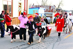 Grier Gables got into the cowboy country theme of Sunday's Lansdowne Santa Claus Parade by bringing many happy faces and a small sea of horses to the village streets. NICK GARDINER Gananoque Reporter