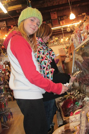 Emma and Lauren Ward, from Didsbury, check out the holiday chocolate treats at the Candy Store. They were passing through Nanton, and stopped to check out the deals on Saturday