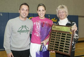 Mother Teresa Spartans basketball player Rebecca Harmsworth is joined by her coach, Jami Pizzari, left, as she is presented with the Fran Wigston Award by Fran Wigston-Eberhard during halftime at the TVRA all-star game at Strathroy District Collegiate Institute in Strathroy on Tuesday. The award is given to the outstanding graduating player as voted by coaches and members of the media. (CRAIG GLOVER, The London Free Press)