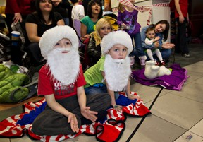 Children enjoy a past edition of the Jingle On Santa Claus parade in downtown Edmonton.