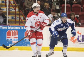 Soo Greyhound Andrew Fritsch (7) and Sudbury Wolves Jeff Corbett (5) skate after puck on Wednesday Nov., 28, 2012. The game was played at the Essar Centre in Sault Ste. Marie, Ont., final score not yet available. RACHELE LABRECQUE - SAULT STAR/ QMI AGENCY